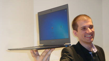 Man holding Ultra Lightweight Laptop in One Hand