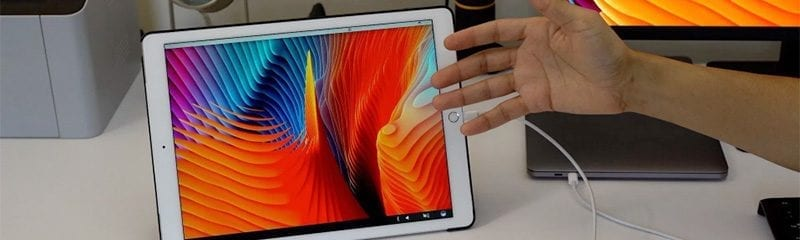 Person showing of their iPad as a External Display