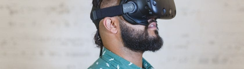 Side view of a man trying the Vive VR Headset