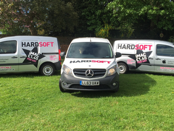 Three HardSoft vans lined up with off-site engineers