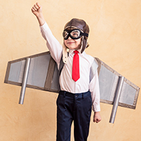 child in aviator costume