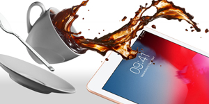 iPad Pro with cup of coffee spilling onto it