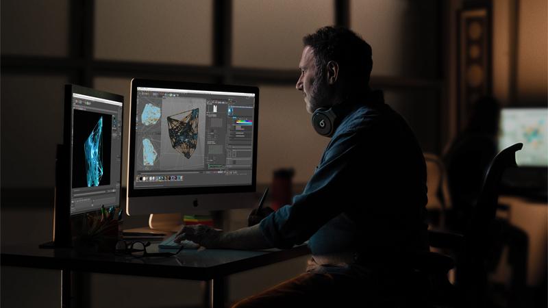 iMac Apple Desktop & user using creative editing software