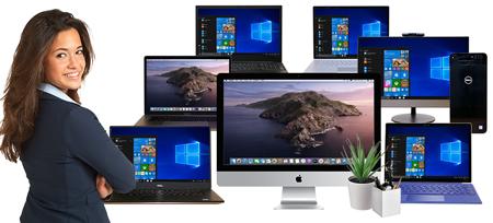 Women standing in front of PC & Mac Desktops, monitors & Laptops