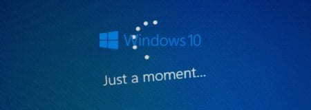 """Windows blue screen updating with """"just a moment"""" in white"""
