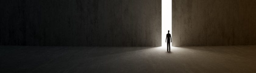 Windows 7 End of Life. Man walking into the light through a doorway
