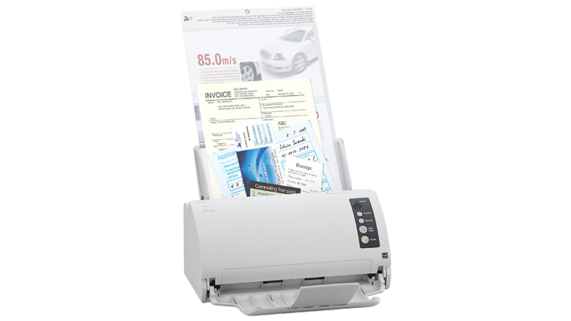Fujitsu FI-7030 scanner front view with documents inside the feeder