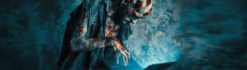 Zombie working on a laptop