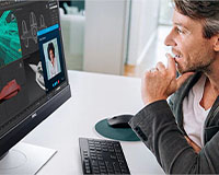 "Dell 24"" Video Conferencing display showing man in virtual meeting"