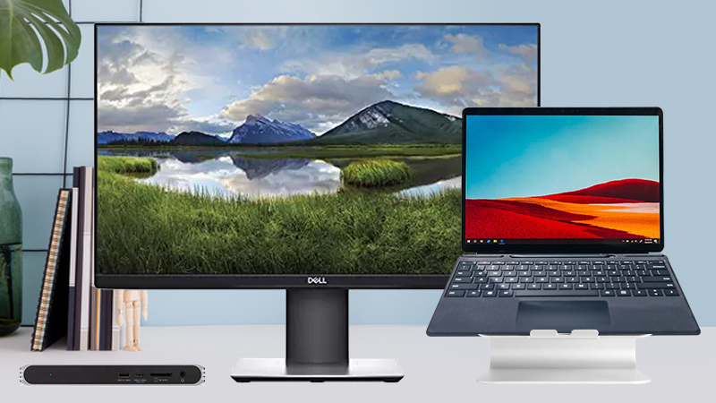 Work From Bundle with Dell display, mStand and CalDigit USB-C Pro Dock showing it set up at home with a laptop