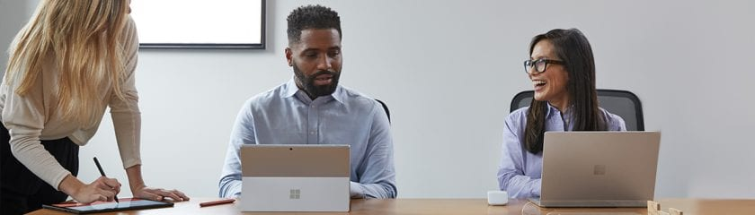 Office meeting taking place with Microsoft Surface devices